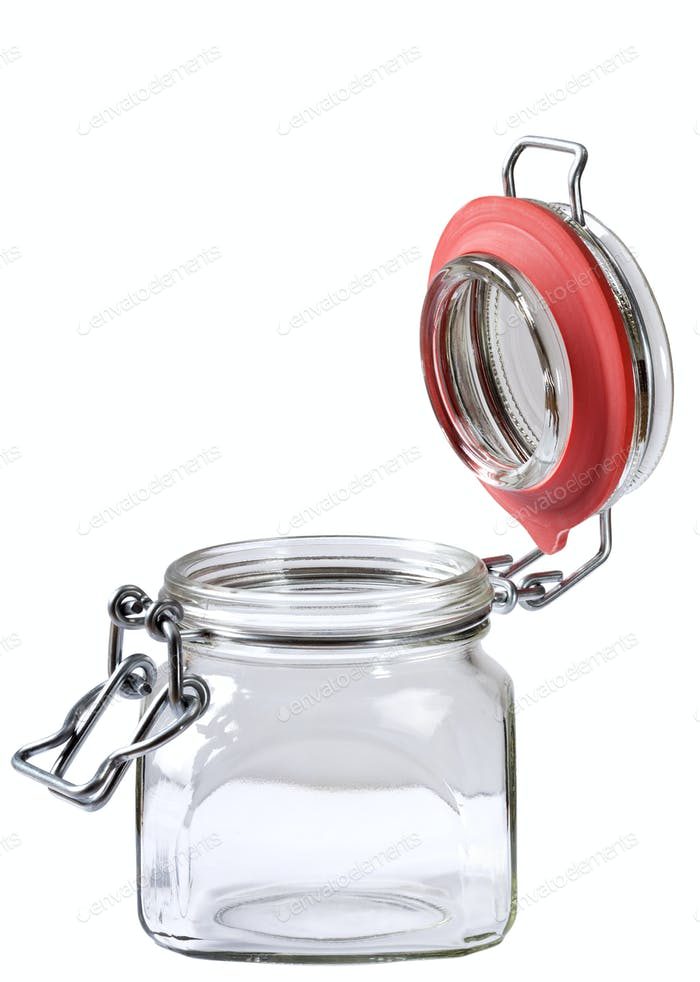 Empty glass jar with the open cap hold isolated on white