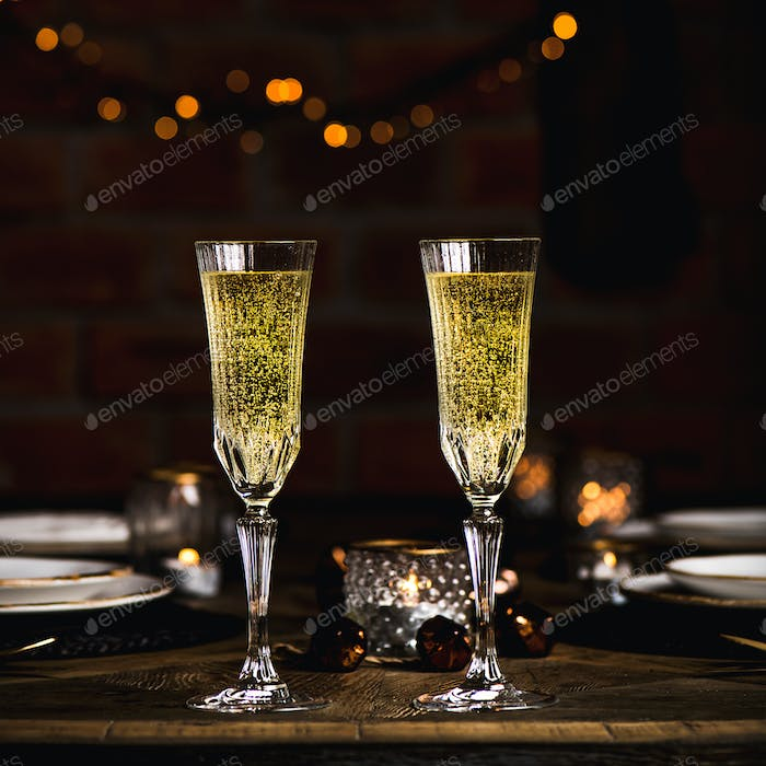 Christmas, New year celebration table set with champagne, square crop