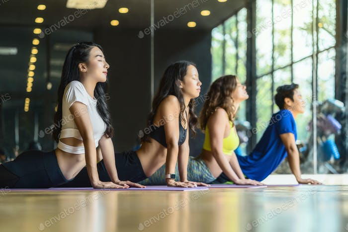 Group of diversity practicing yoga class, healthy or Meditation Exercise,stretching
