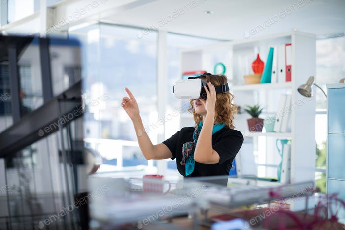 Female designer using virtual reality headset