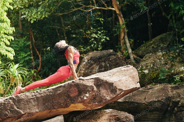 Woman doing cobra asana