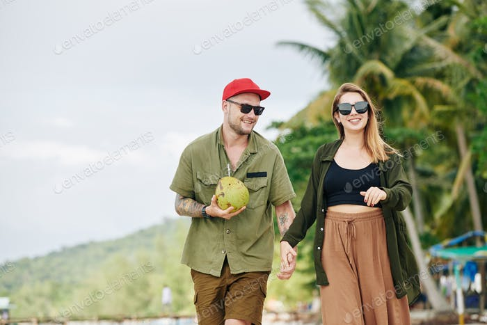 Young couple spending vcations on beach