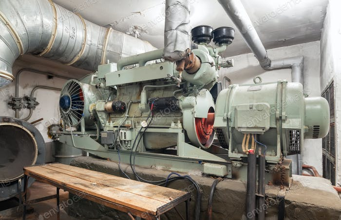 Big old diesel generator inside an shelter