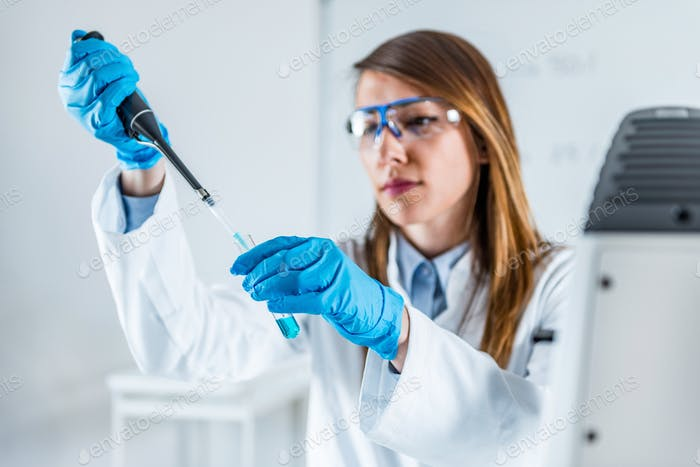 Laboratory technician using micro pipette