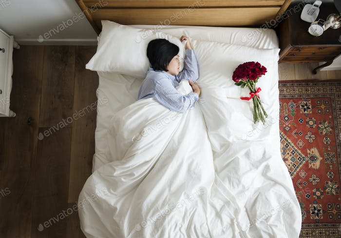 Woman sleeping and a bouquet of flower romance concept