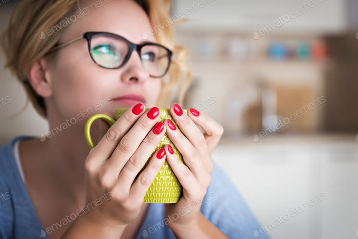 Woman holding green mug