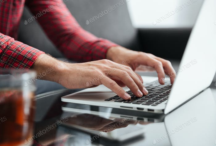 Close up of man typing on keyboard