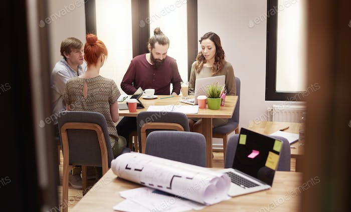 Young people working at the office