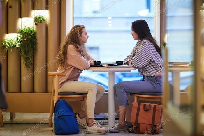 Friendly girls in cafe
