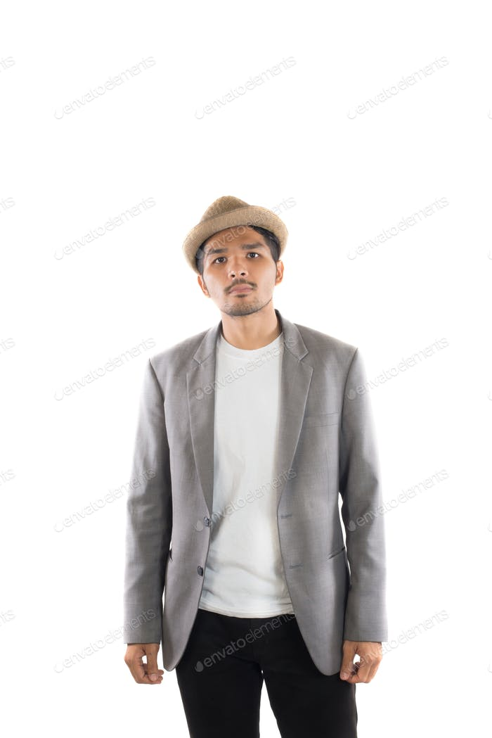 Portrait of young hipster man in gray suit casual poses at studio.