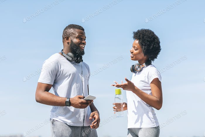 Afro Coach Guy Talking To Girl During Morning Jog Outside