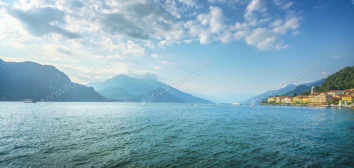 Bellagio town, Como Lake panoramic landscape and ferry boat. Italy, Europe.