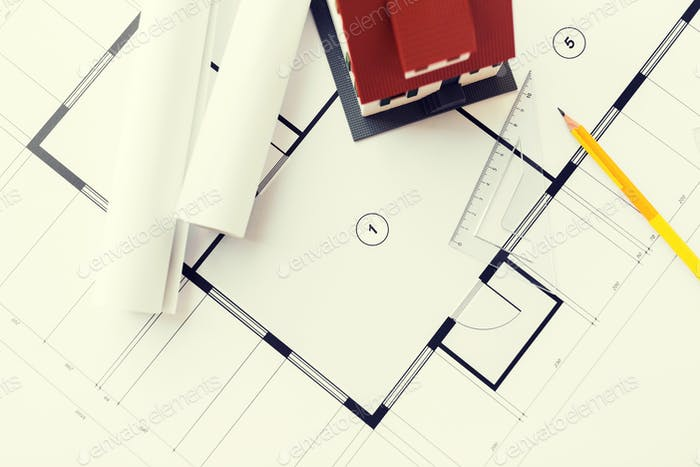 close up of house model on architectural blueprint