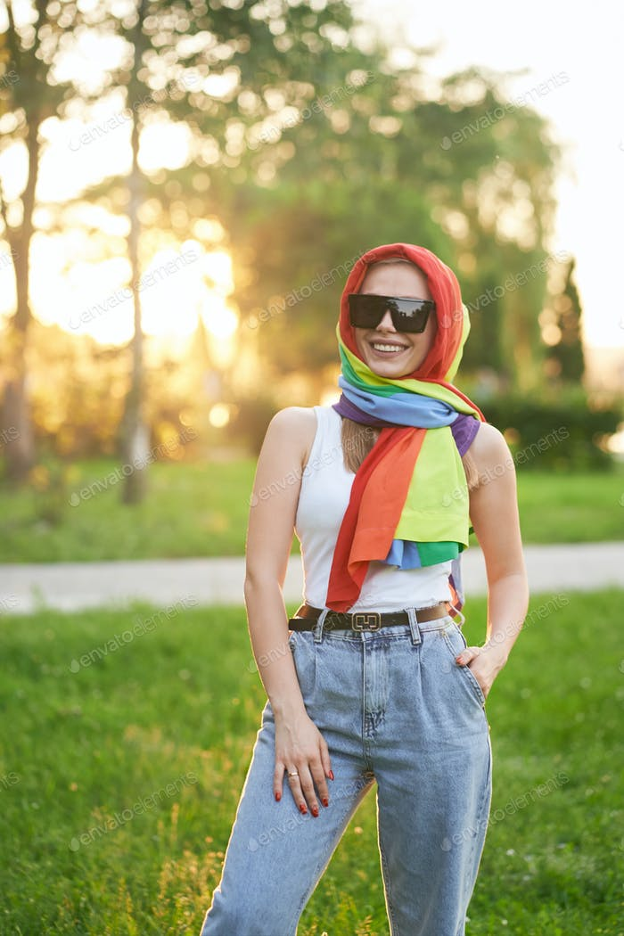 Smiling woman with rainbow scarf on head