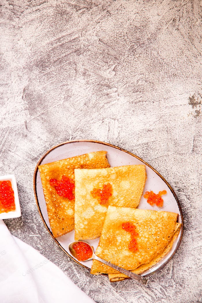 Traditional Russian pancakes with red caviar