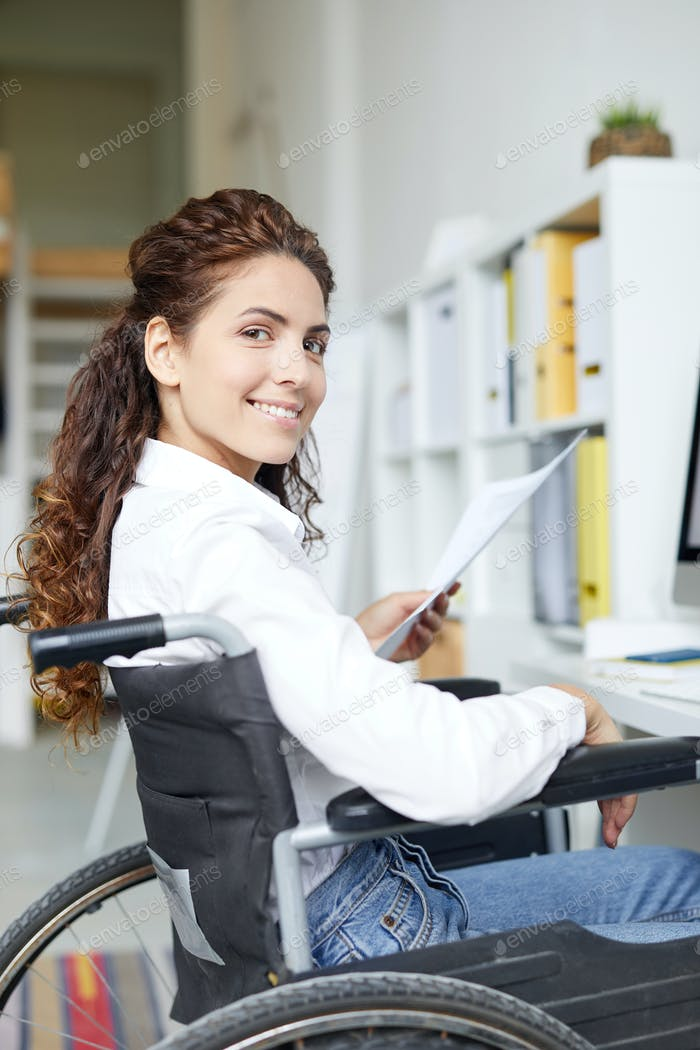 Young accountant in wheelchair