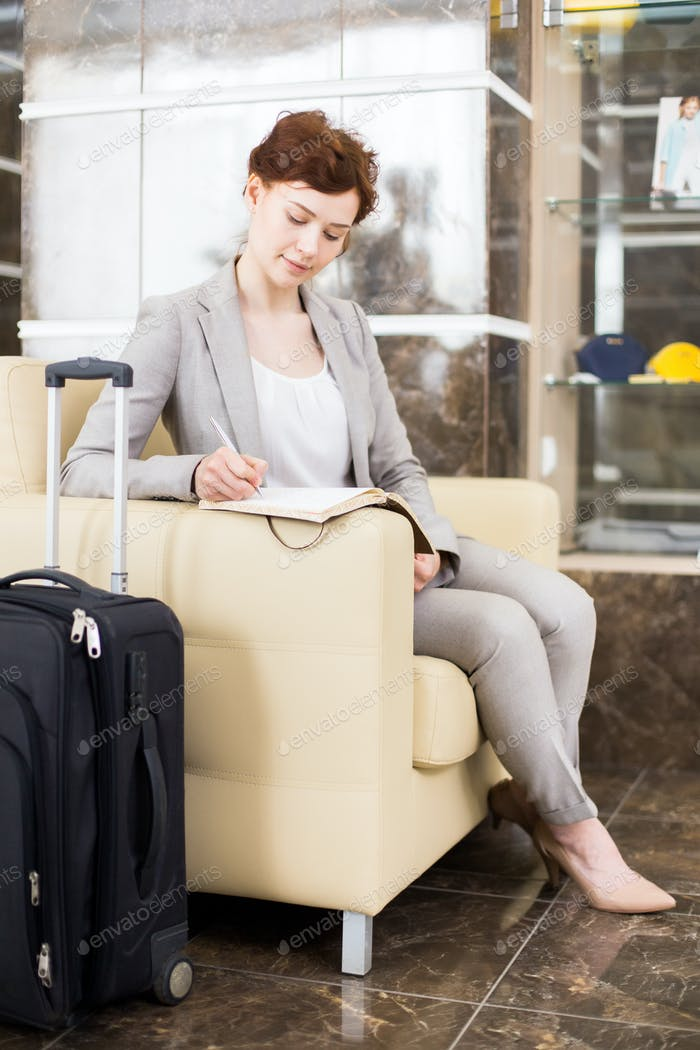 Young Businesswoman waiting in Hotel Lobby