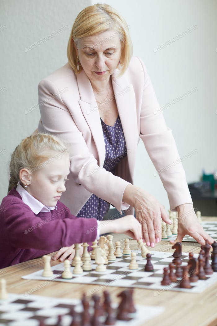 Practicing chess with teacher