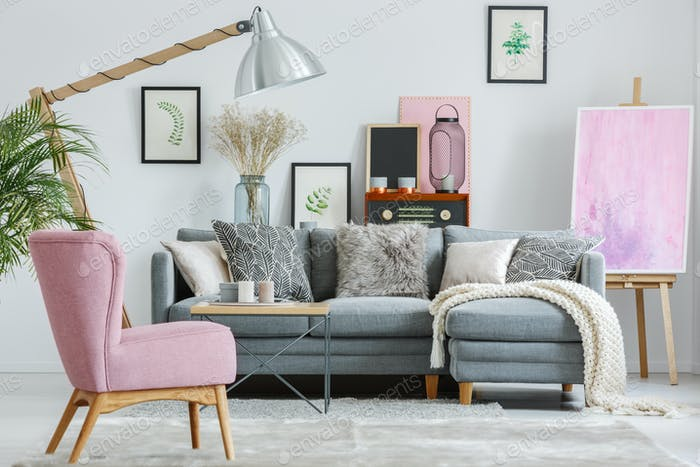Pink armchair on grey carpet