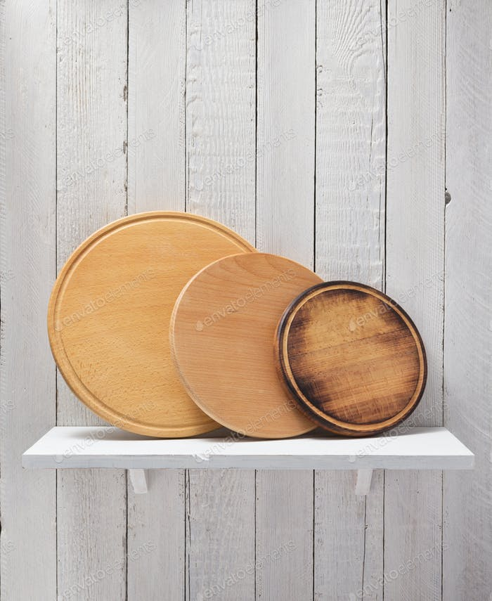 pizza cutting board at wooden shelf