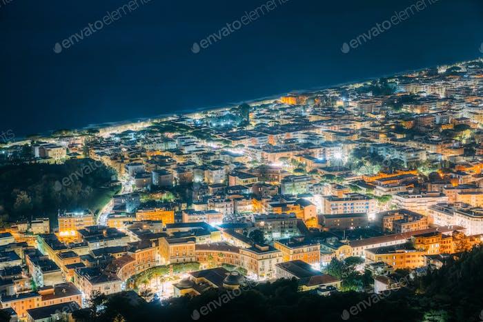 Terracina, Italy. Top Cityscape In Evening Night Illuminations