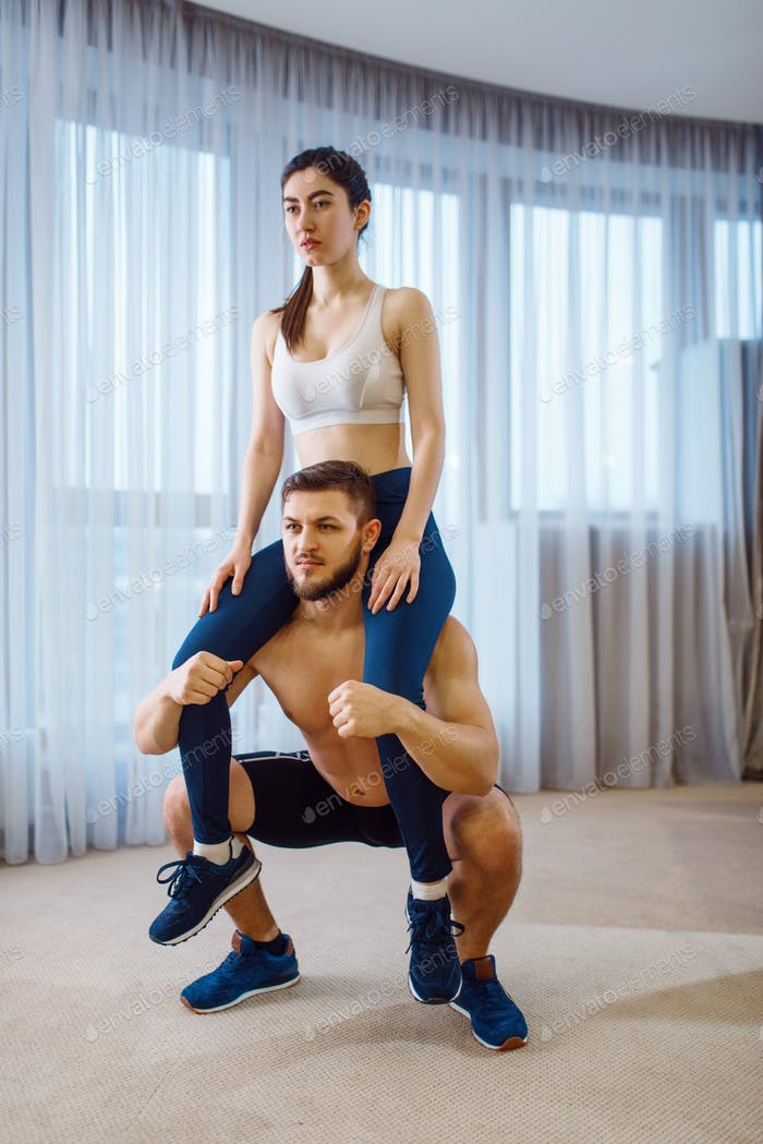 Aerobic workout of beautiful love couple at home