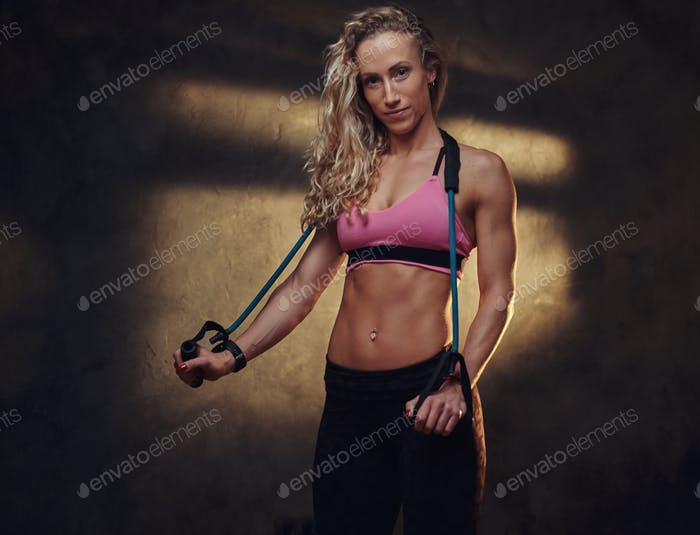 Portrait of pretty blond woman in sport suit
