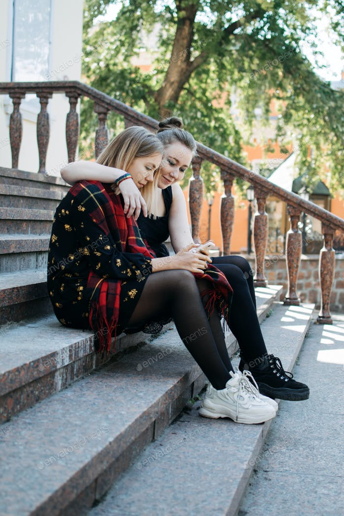 LGBT Lesbian couple love moments concept. Two Young lesbians girls hugging and walking outdoors