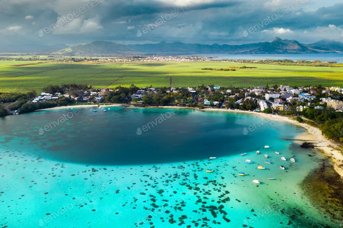 Top view of the Blue Bay lagoon of Mauritius. A boat floats on a turquoise lagoon