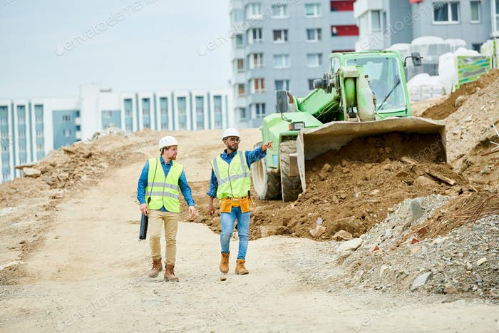 Men inspecting construction site