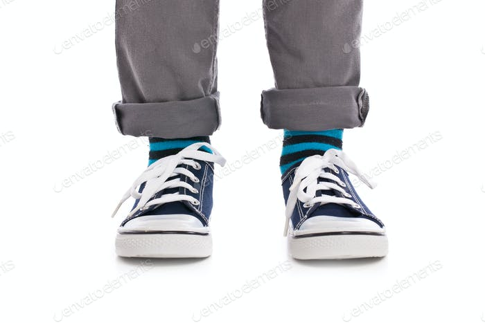 Close-up on child feet with sneakers