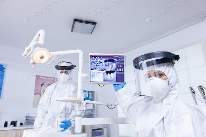 Patient pov of orthodontic doctor explaining patient x-ray