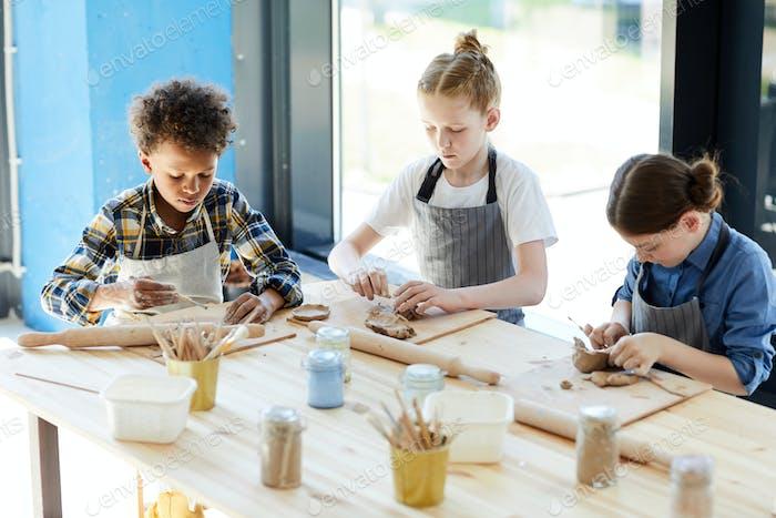 Kids making earthenware