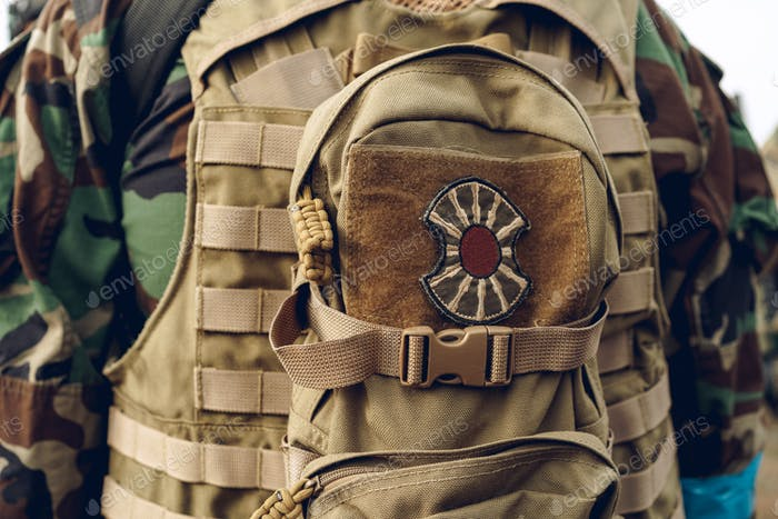 Military backpack with a patch stitched on the outside