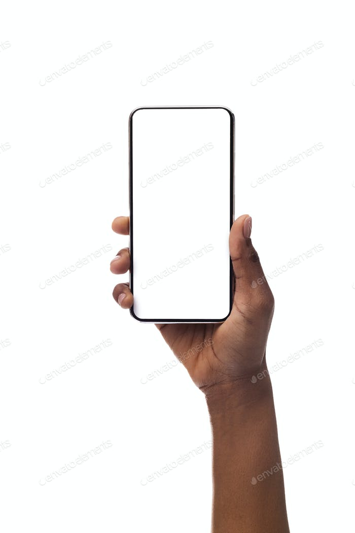 Woman's hand holding smartphone with blank screen, isolated on white background