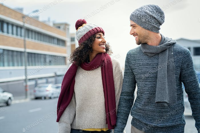 Multiethnic couple in love walking during winter