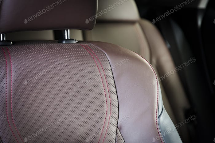Red headrest in modern car interior