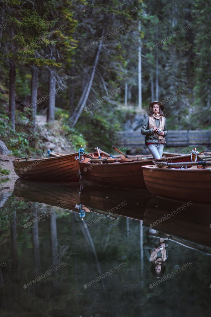 Young photographer with a retro camera in a boat