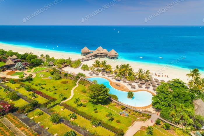 Aerial view of beautiful hotel on the sea. Sandy beach