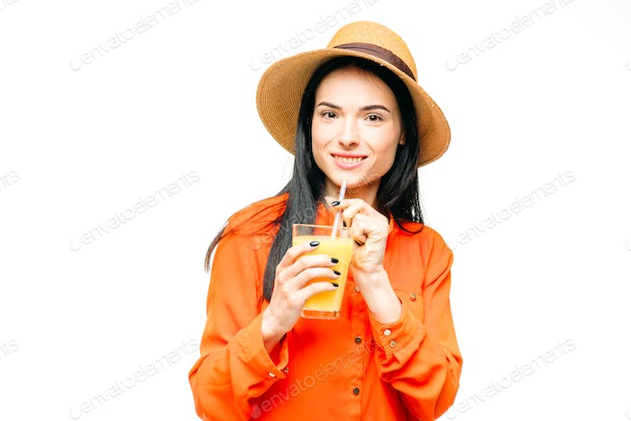 Woman drinks fresh juice fruit, white background