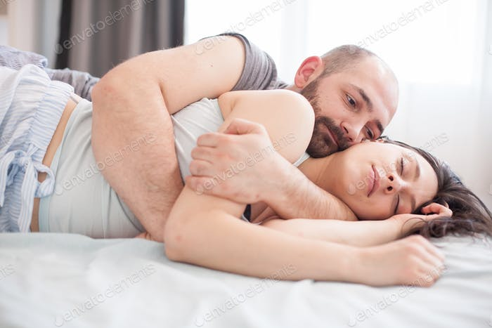 Portrait of bearded man snuggle with his girlfriend
