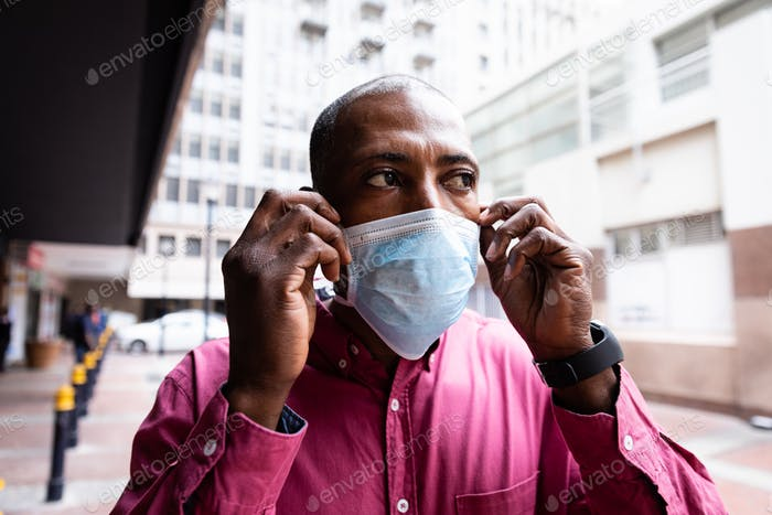 African American wearing covid19 coronavirus mask in the street
