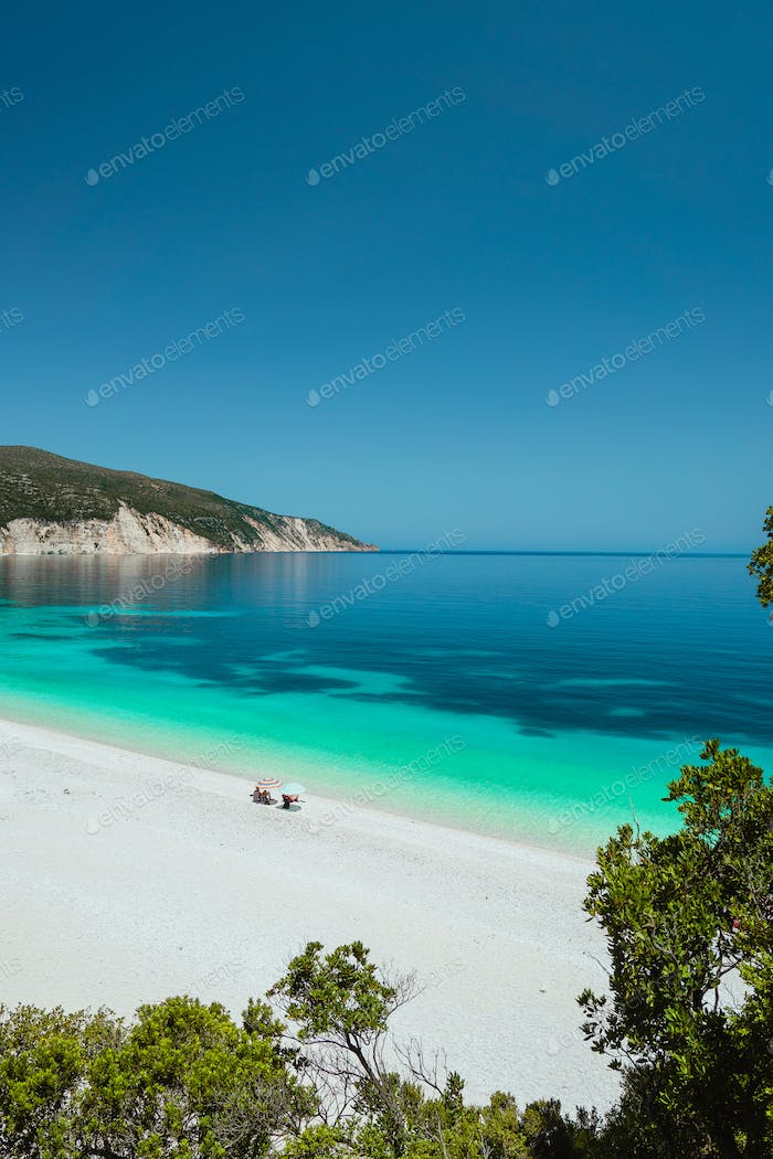 Couple enjoying the summer on one of the most beautiful beaches of Greece on Kefalonia Island Ionian