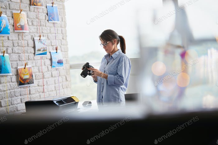 Photographer Working In Studio With Dslr Camera And Computer