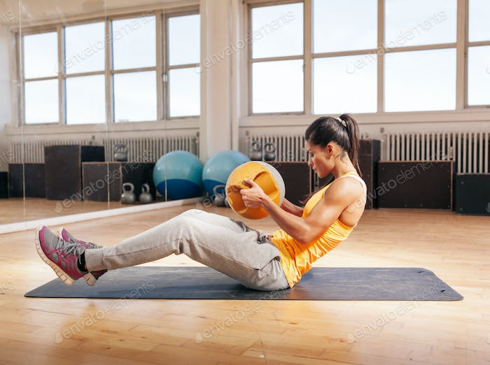 Young fitness woman exercising in gym