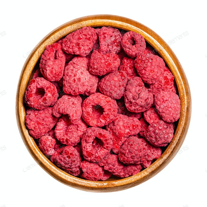 Dried whole raspberries in a wooden bowl