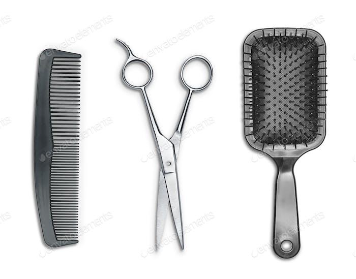 Schere, Kamm und Haarbürste