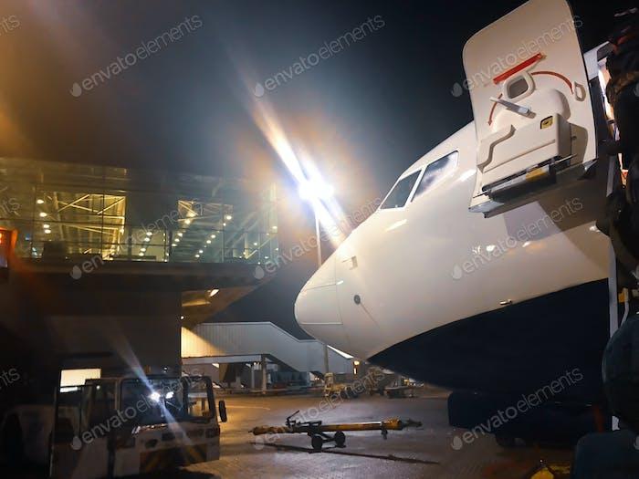 Airplane at the airport terminal runway