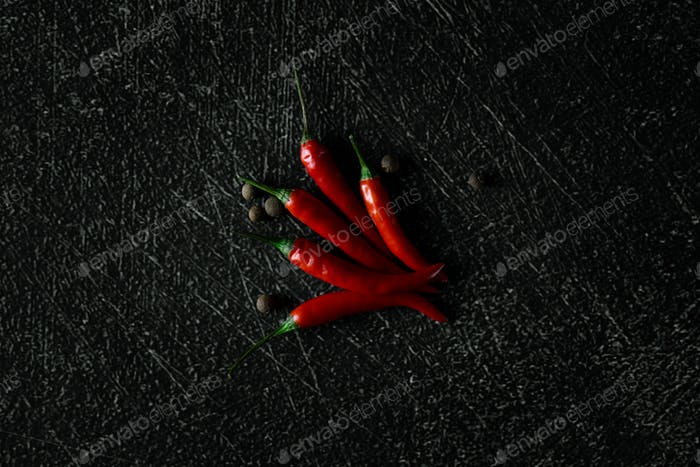 Red chili on black background (high angle view).