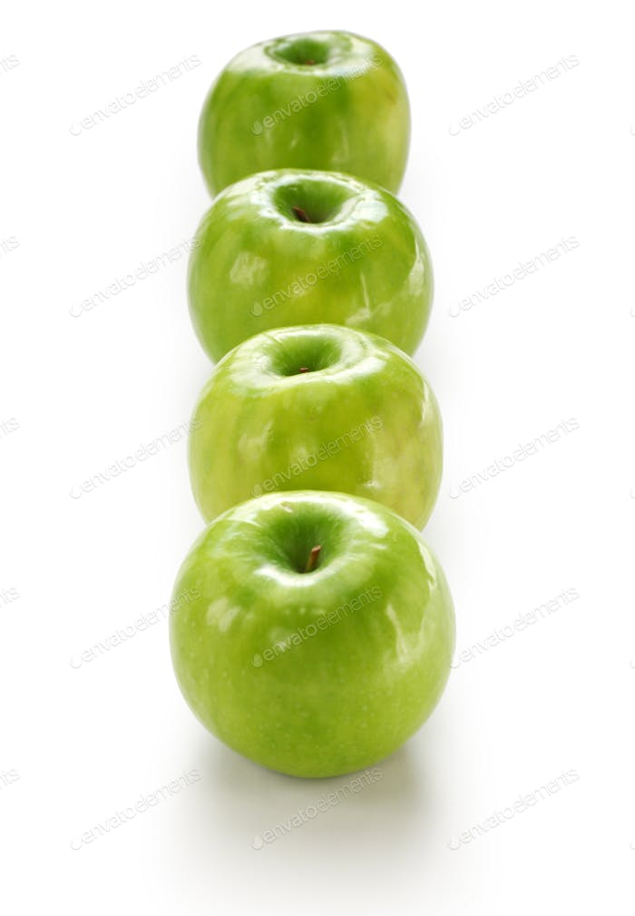 four green apples isolated on white background